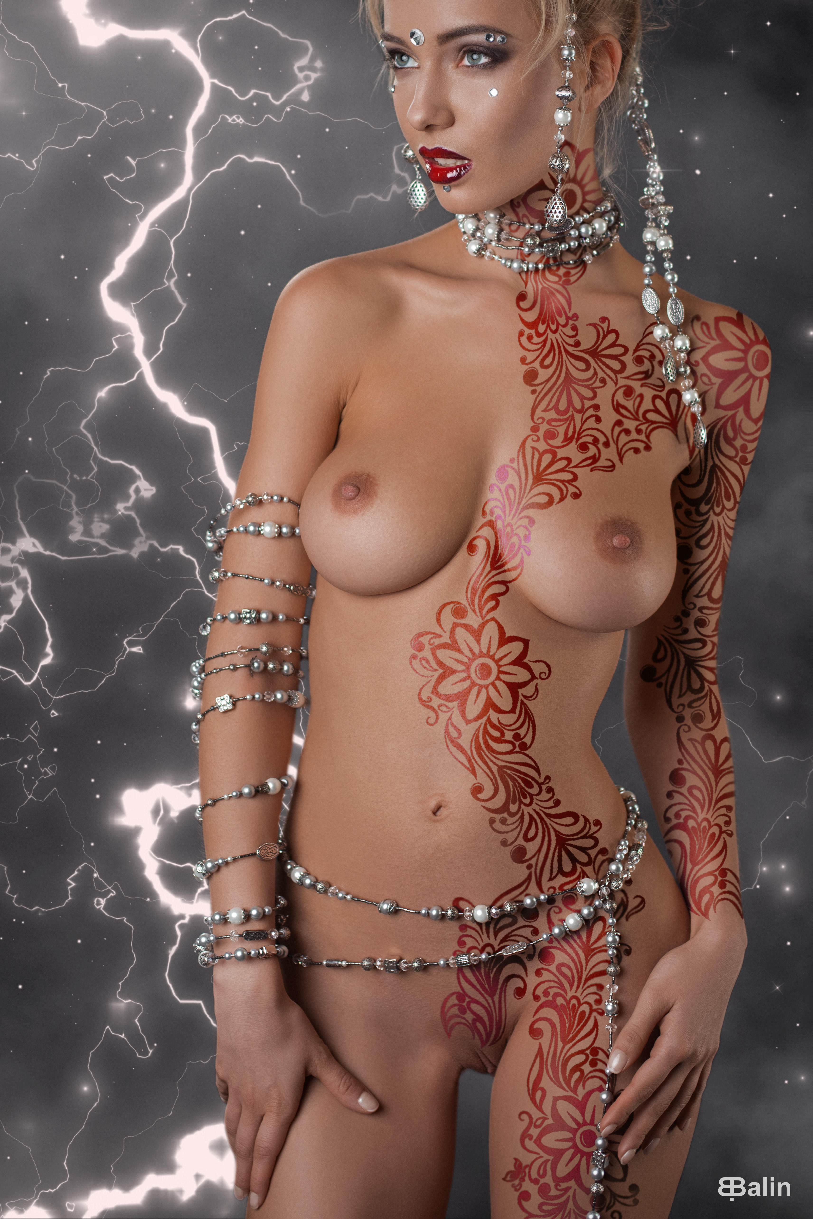 Nude girls wearing jewelry