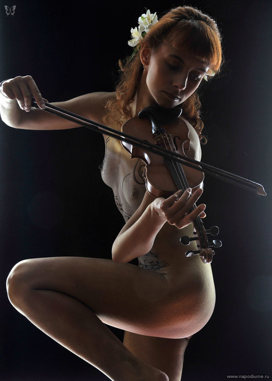 Naked girl with a violin