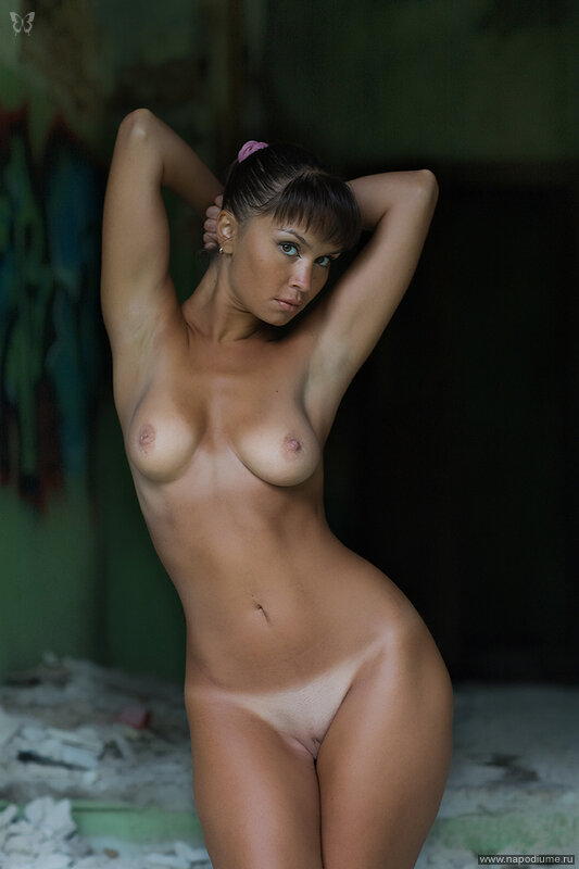 Nude female models with tan lines